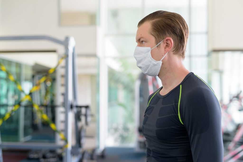 profile-view-of-young-man-with-mask-for-protection